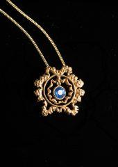 karmapa-gold-pendant-v2-blue_sapphire-gem-851x1200