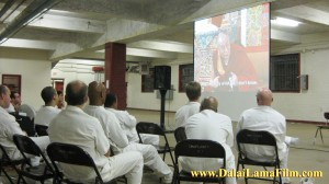 Inmates at the Ramsey maximum security prison in Texas watch the film, 'Dalai Lama Renaissance' (narrated by Harrison Ford). Half of the inmates in the audience were convicted of murder.