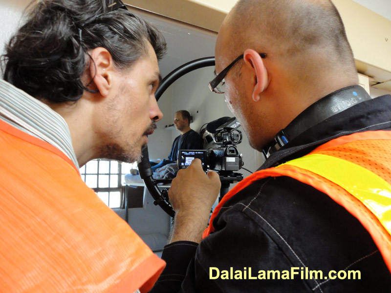 Dalai Lama Renaissance Crew Member Leo D speaks with Director Khashyar Darvich during filming of a Dalai Lama Prison Film