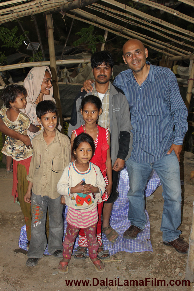 Producer-Director Khashyar Darvich (right) with Viru's family, in their village in the Himalayan mountains of India. None of his children have ever attended school, until this month.