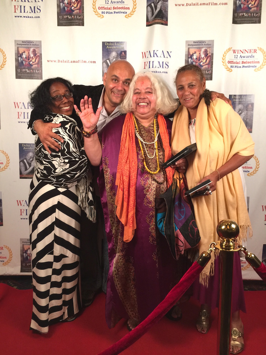 Director Khashyar Darvich with ladies from the red carpet premiere of Dalai Lama Awakening