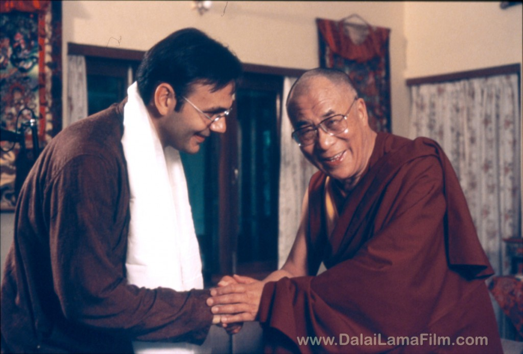 Dalai Lama giving blessing kata scarf to Director Khashyar Darvich during filming for the Dalai Lama Awakening Documentary Film