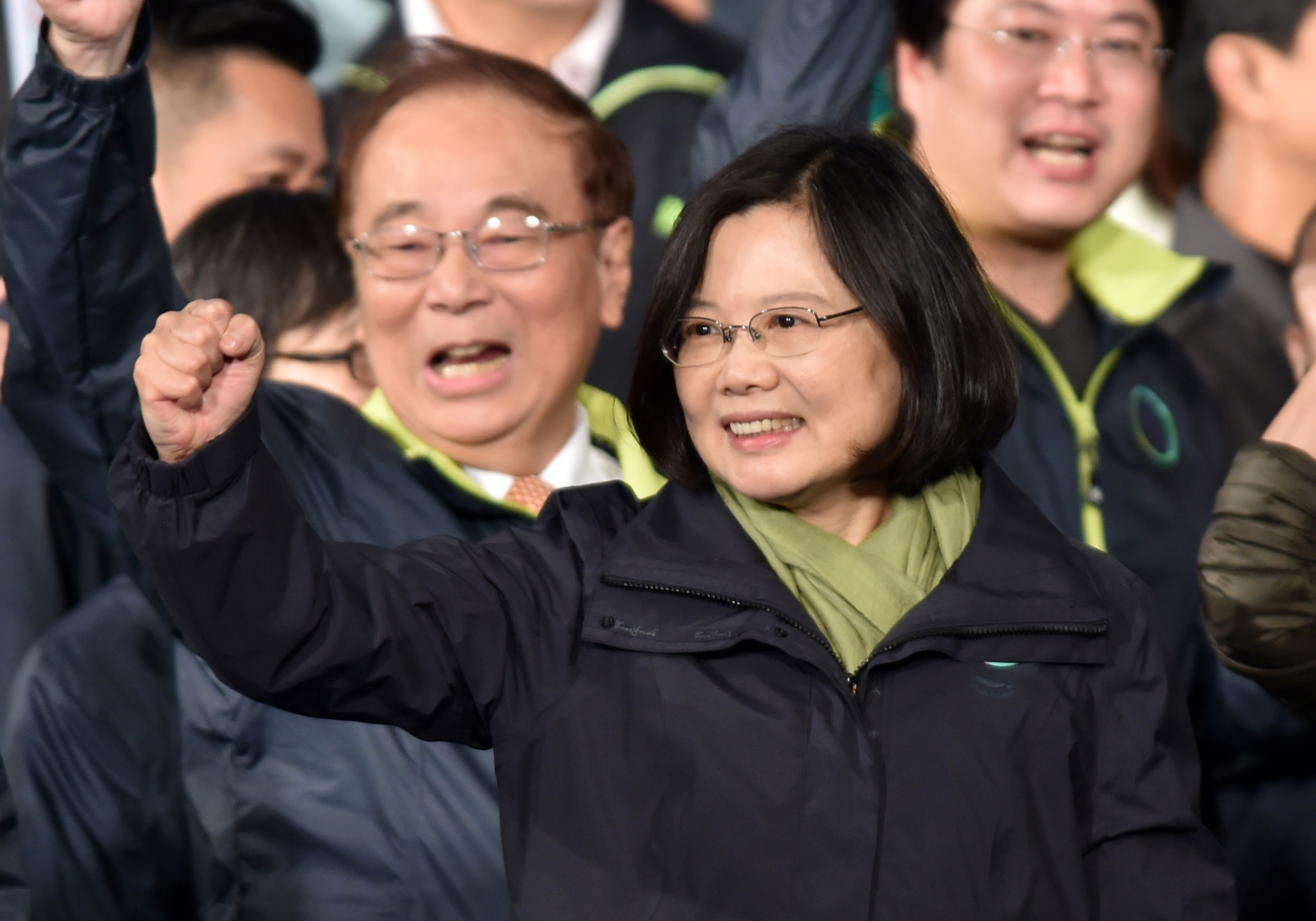 Democratic Progressive Party (DPP) presidential candidate Tsai Ing-wen gestures as she celebrates her victory inTaipei on January 15, 2016. Voters in Taiwan elected a Beijing-sceptic president in a dramatic democratic journey, carving their own political path against China's wishes. AFP PHOTO / Sam Yeh